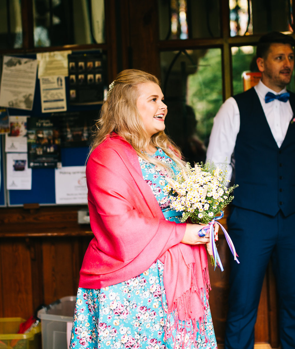 Smiles from a wedding guests, colourful wedding.