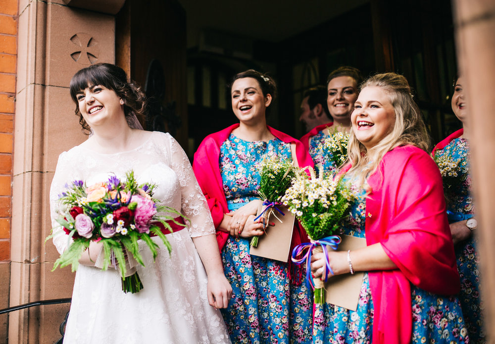 The bride and bridesmaids at the Wellbeing Farm, quirky wedding.