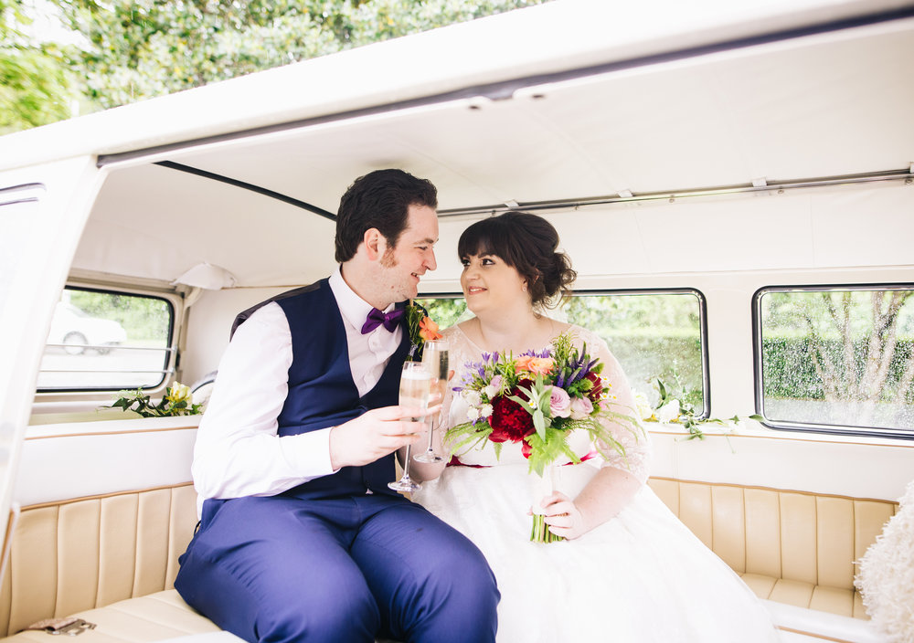 Bride and groom in the wedding car, creative quirky wedding photographer.