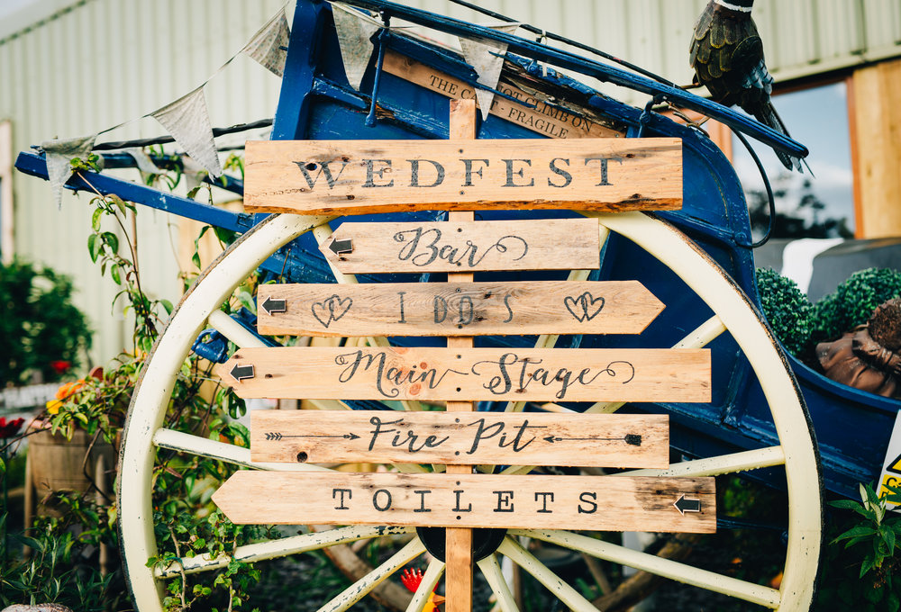 Hand-made wedding sign, colourful quirky wedding.