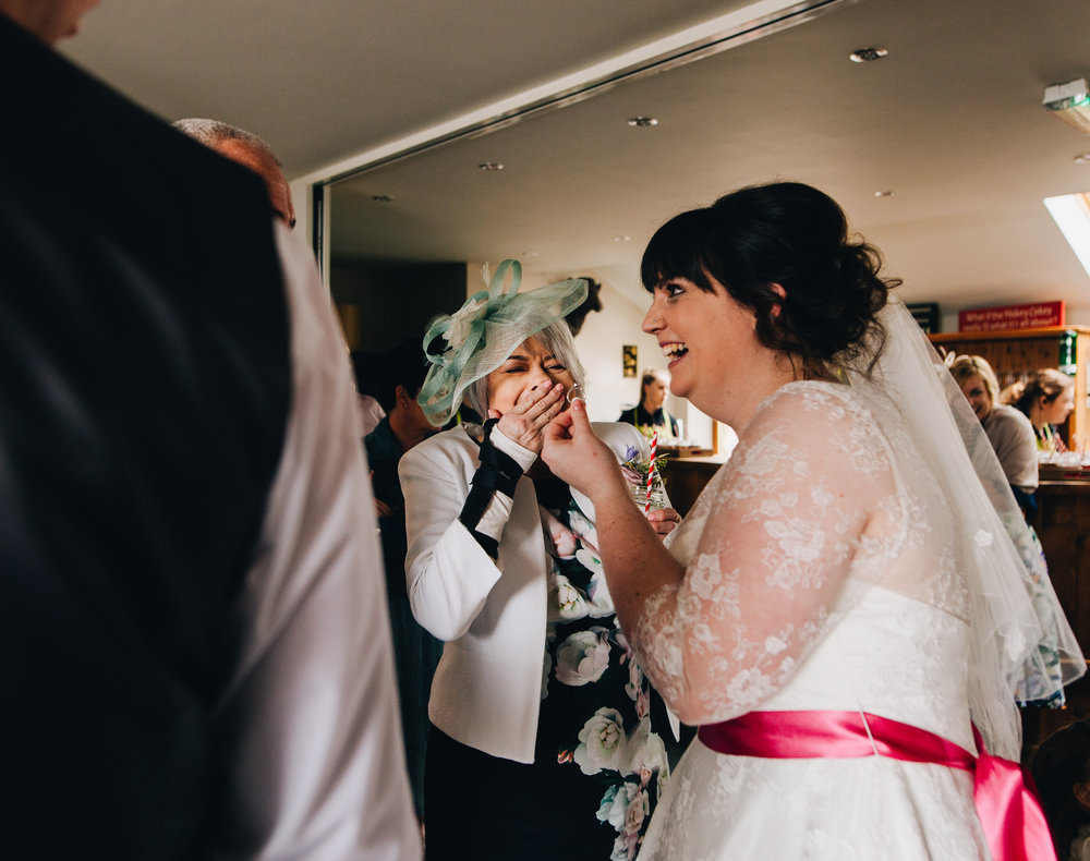 Bride laughing, Documentary wedding photography.