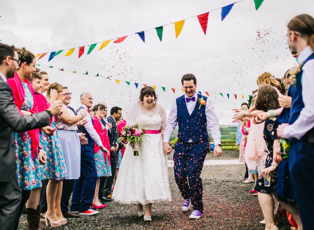Walking through confetti, Colourful quirky wedding at Wellbeing Farm.