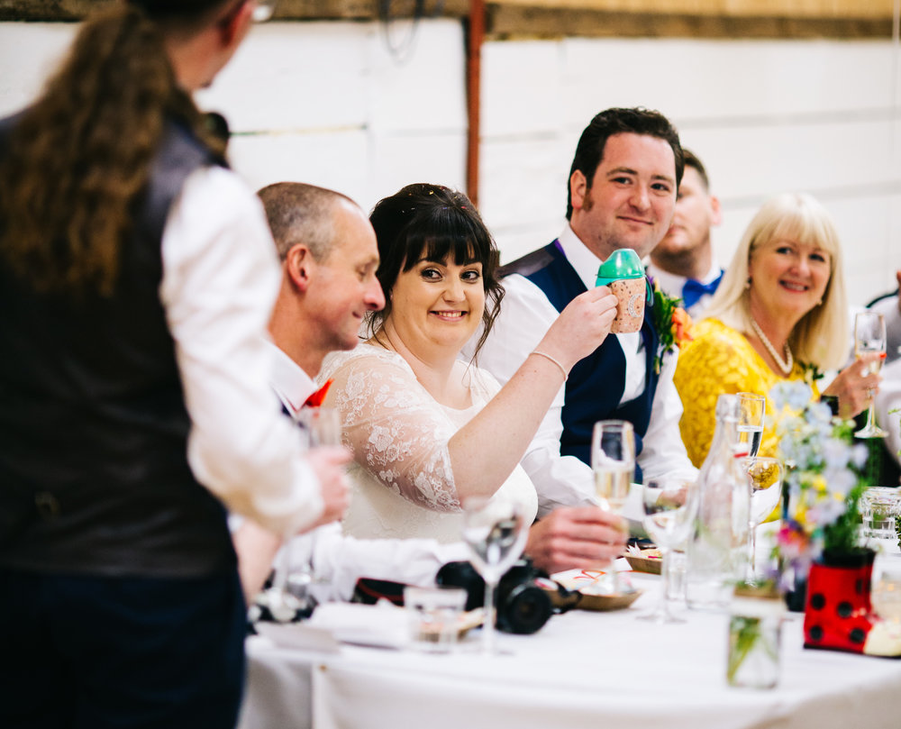 Smiles from the bride during the wedding speeches, Rustic themed wedding.