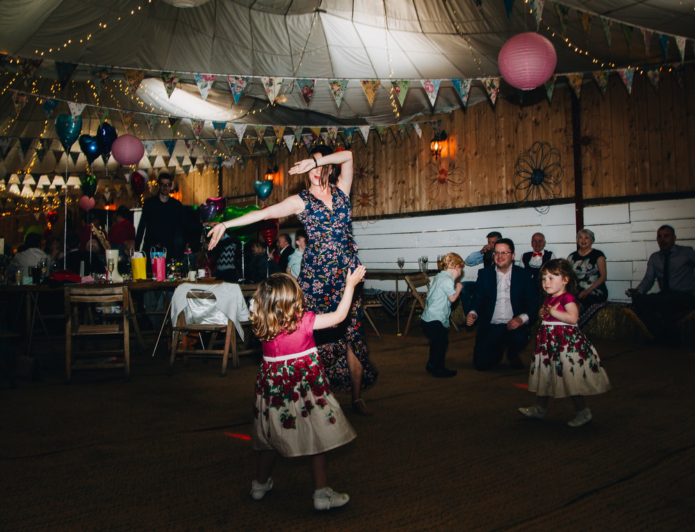 Wedding guests hitting the dance floor, Colourful quirky wedding.