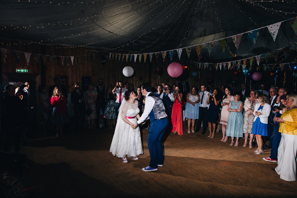 Bride and groom first dance, documentary wedding photographer at Wellbeing Farm.