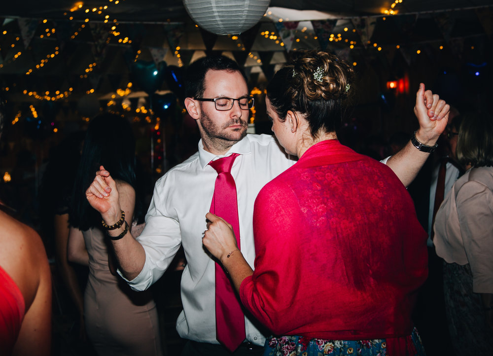 Wedding guests having a dance on the dance floor, Colourful quirky wedding photographer.