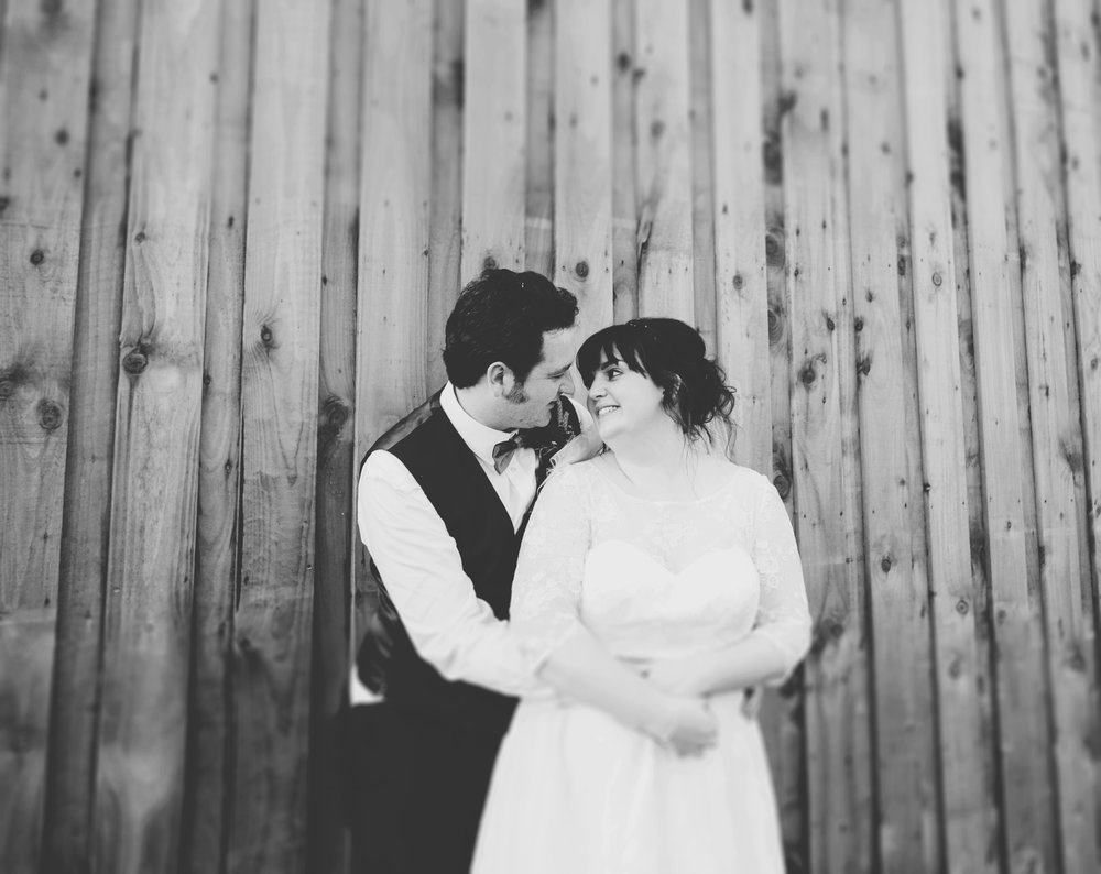 Black and white photograph of the bride and groom, DIY wedding.