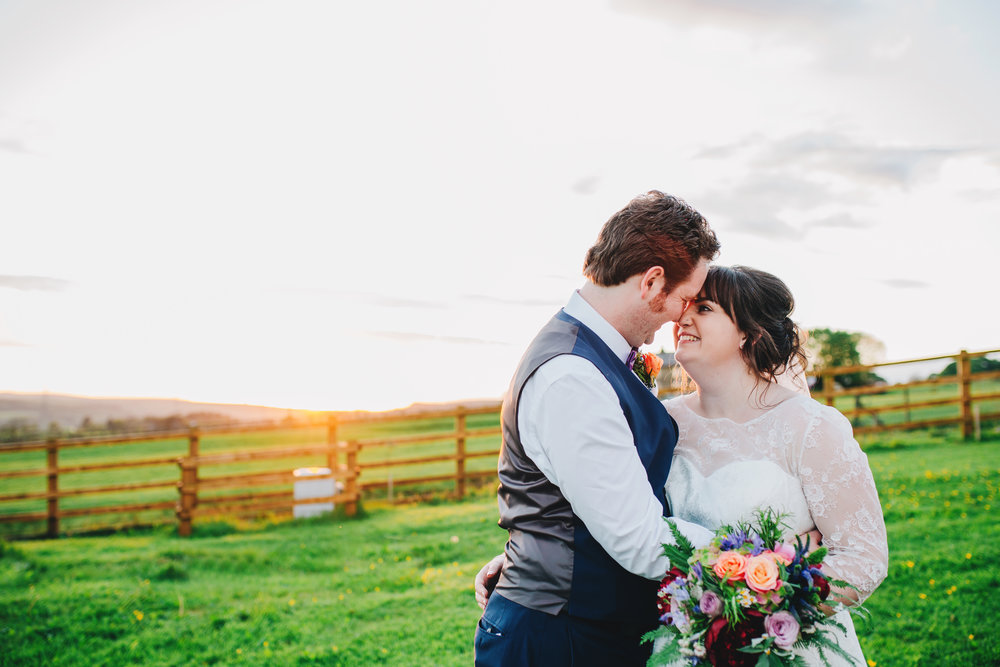 Cuddle for the bride and groom, creative wedding photographer lancashire.