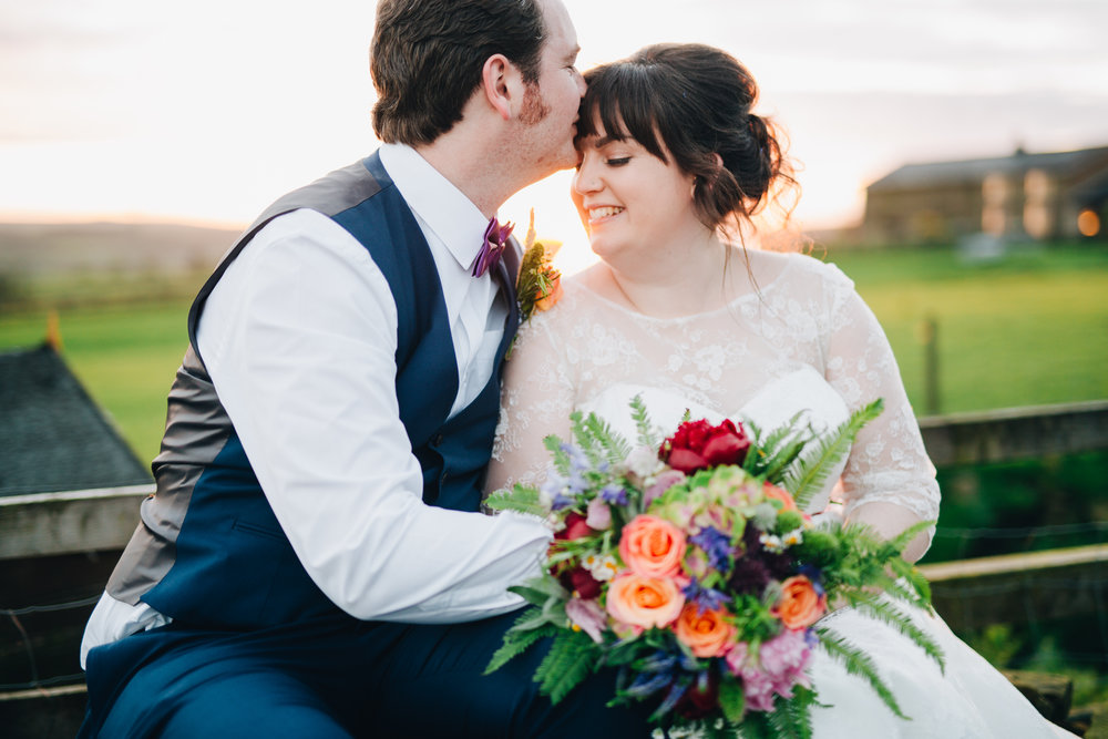 Kisses from the groom to the bride, Colourful quirky wedding at Wellbeing Farm.