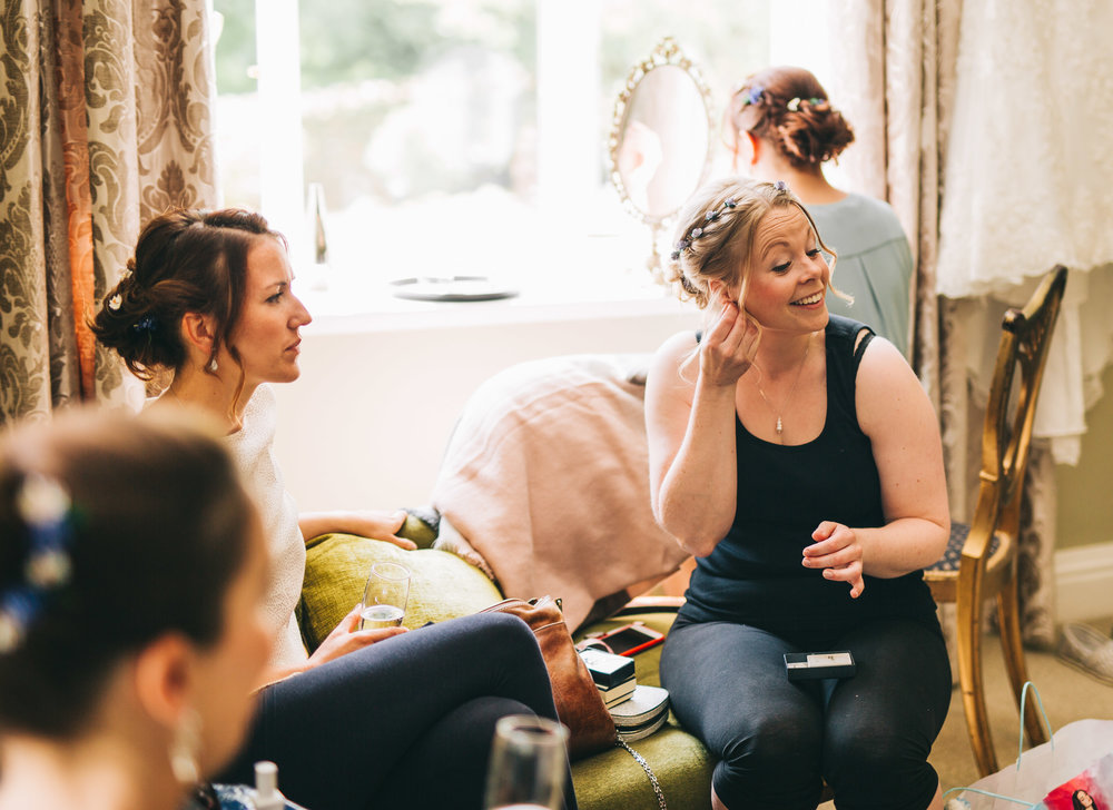 bridesmaids chat as they get ready