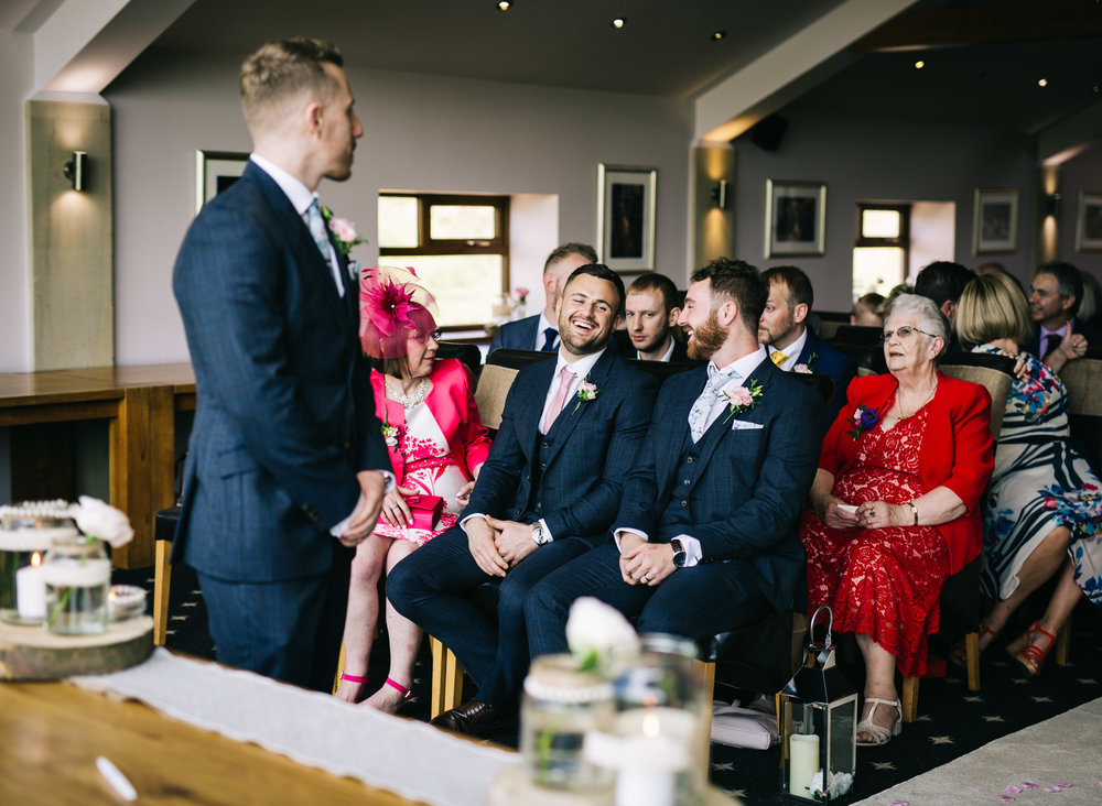 groom laughs with best man - documentary wedding photography