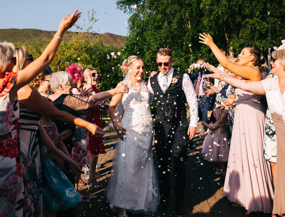 couple walk through the confetti at the fisherman's retreat