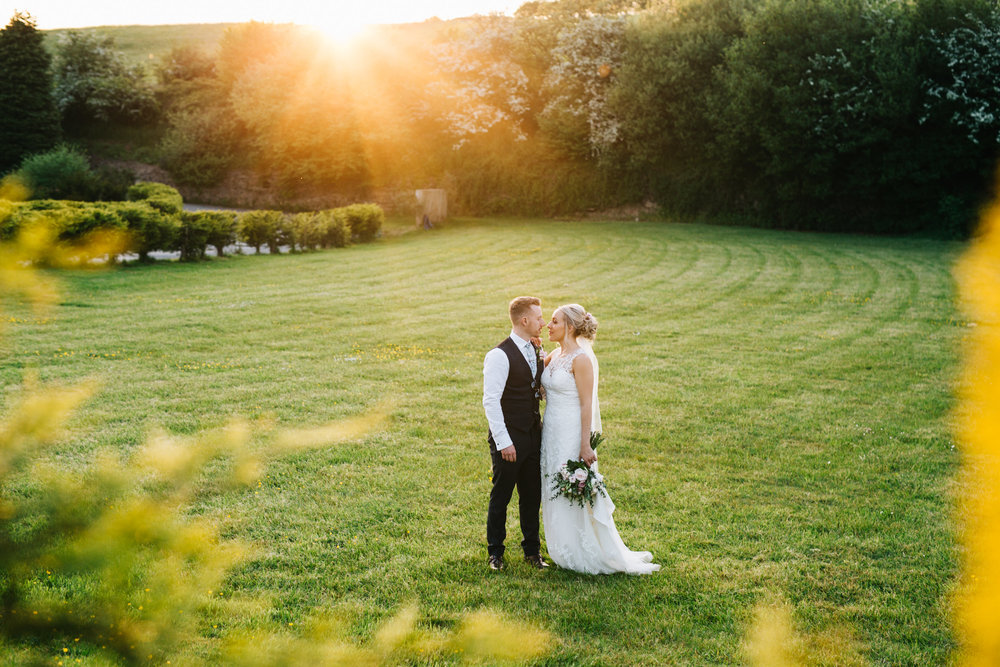 wedding photographer lancashire - creative sunset portraits of the bride and groom