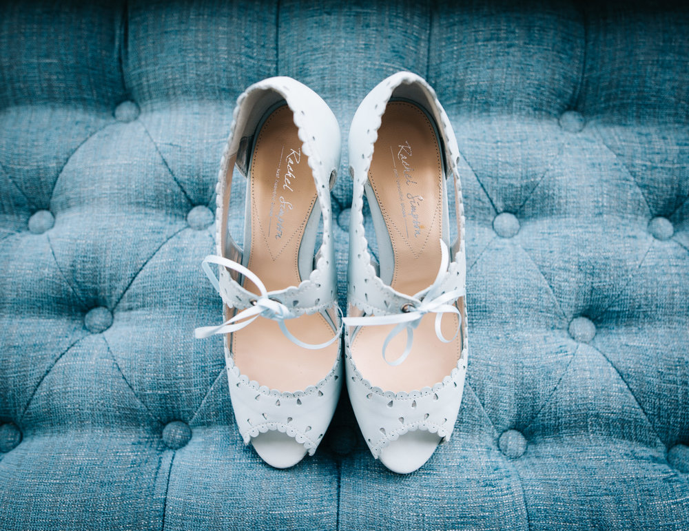 The brides blue shoes on a blue chair, Pastel styled wedding at A Great Hall at Mains.