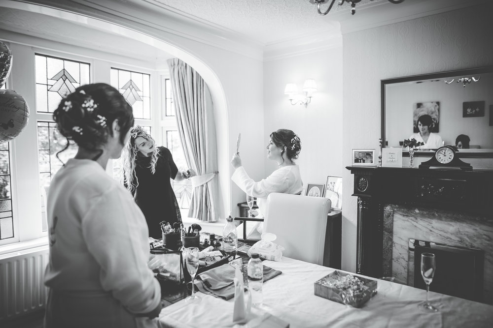 The bridesmaids getting ready, black and white photograph, creative wedding photography.
