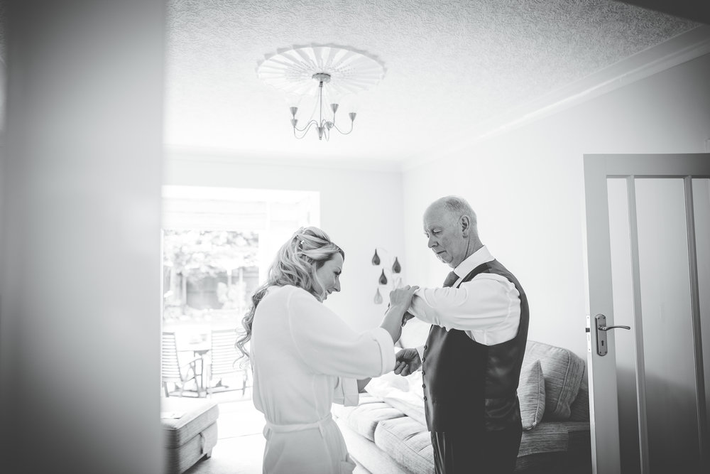 Black and white photograph of the bride and her father, Documentary styled wedding photographer.