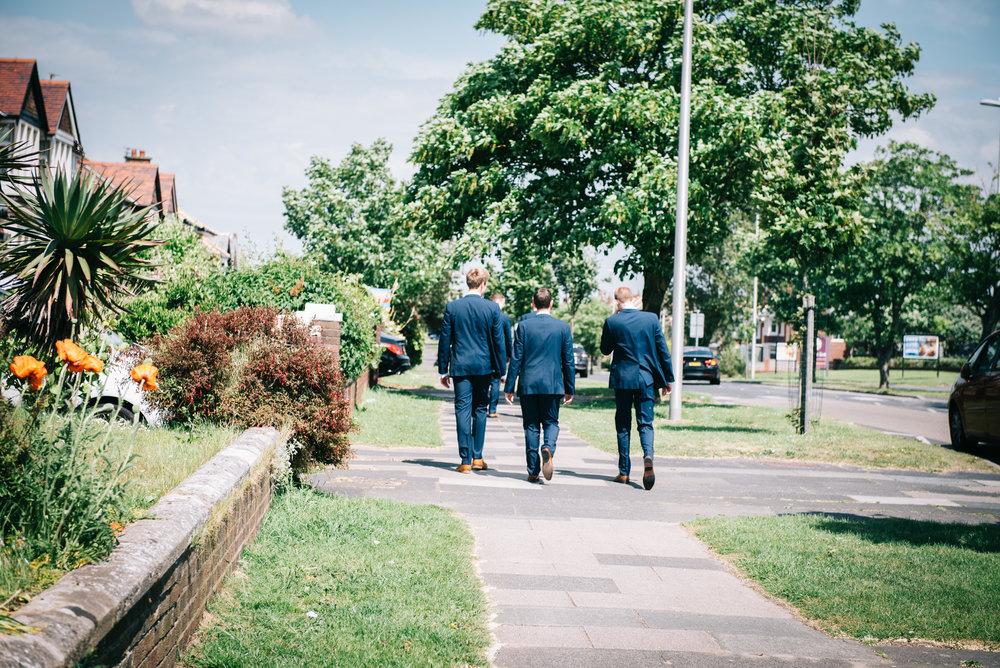 The groomsmen walking to the venue, Documentary wedding photographer.