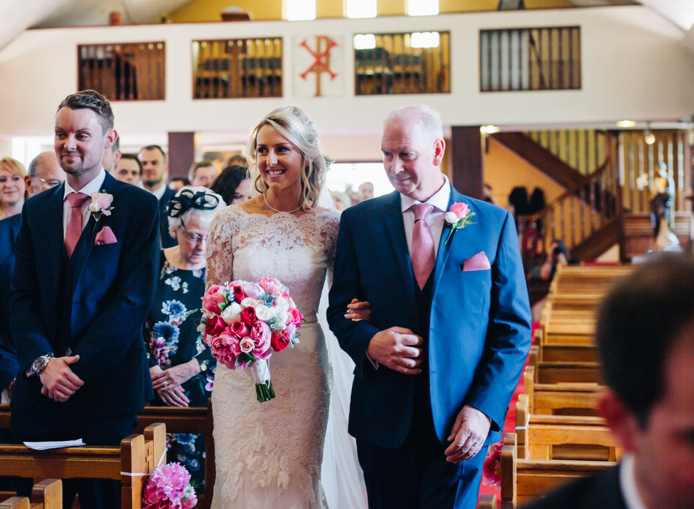 The bride making her way to her groom, Pastel themed wedding at A Great Hall at Mains.