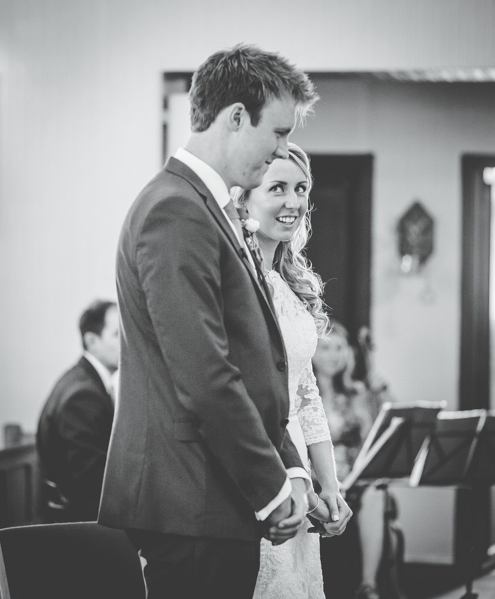 The bride and groom at the alter, Documentary styled wedding photographer.