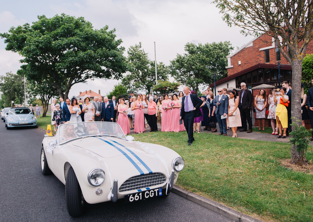 The wedding car at A Great Hall at Mains, Calm relaxed wedding photographer.