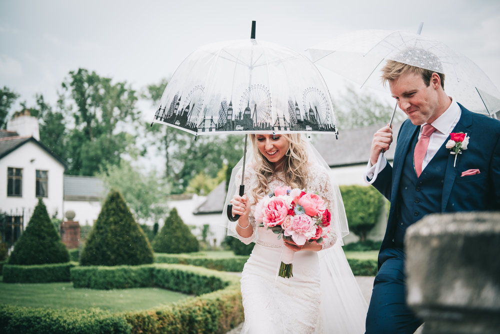 Umbrellas are needed for the bride and groom, creative wedding photographer.