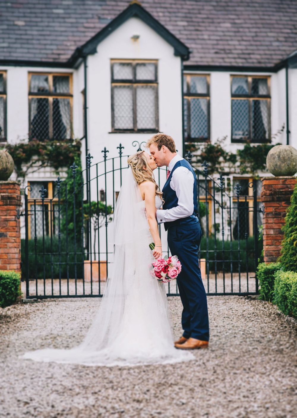 The bride and groom kissing at A Great Hall at Mains, Creative wedding photographer.