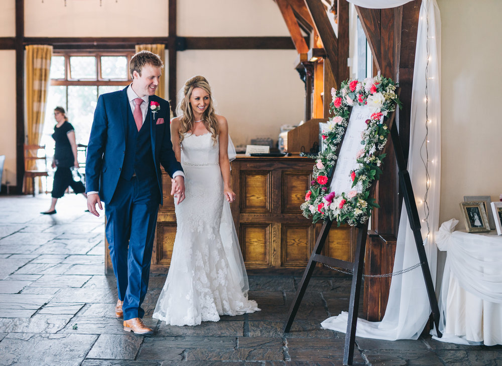 The bride and groom about to enter the meal room, Documentary wedding photography.