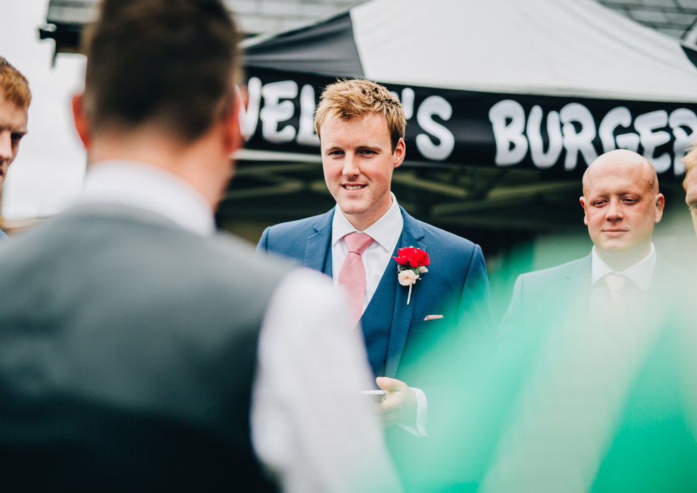 Smiles from the groom, Creative wedding photography at A Great Hall at Mains.
