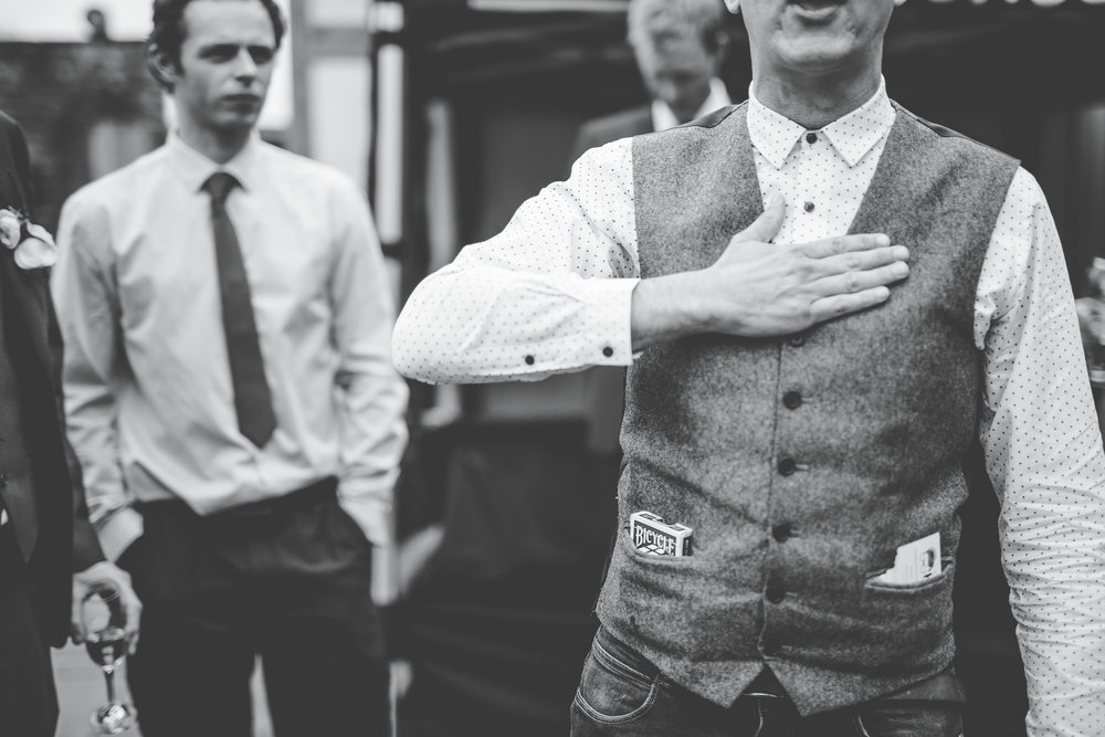 Black and white photograph of dancing from wedding guests, calm and relaxed wedding.