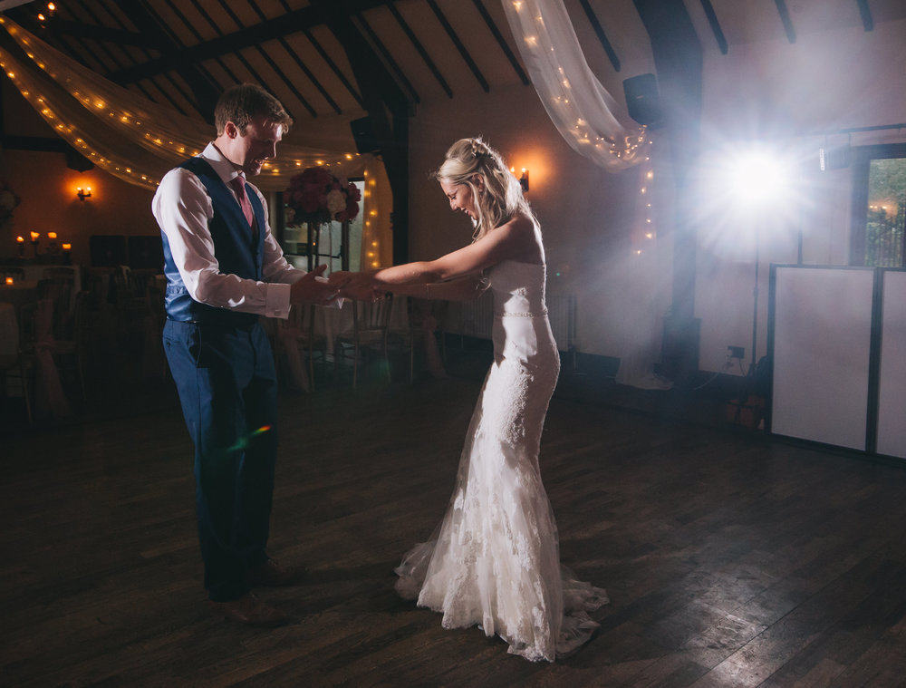 The bride and groom first dance on the dance floor, Calm and relaxed wedding photography.