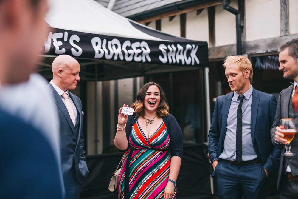 Laughter from the wedding guests at A Great Hall at Mains, Creative wedding photograph from Lancashire.