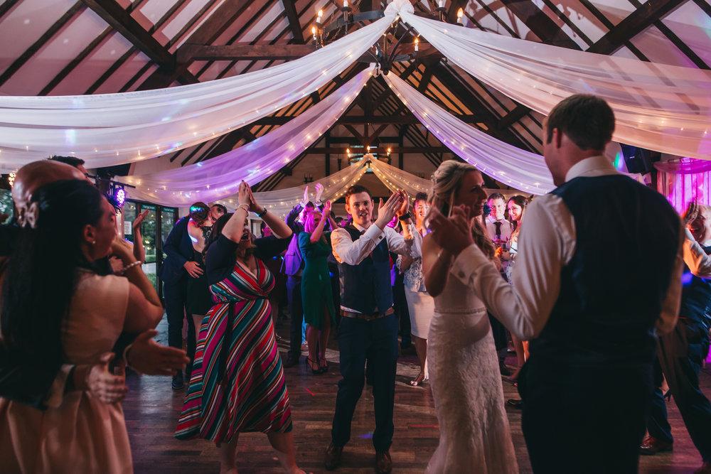 The bride and groom on the dance floor, Documentary styled wedding photographer.