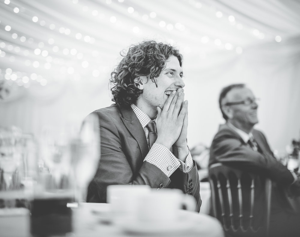 guests laughs during the speeches - wedding photography in lancashire