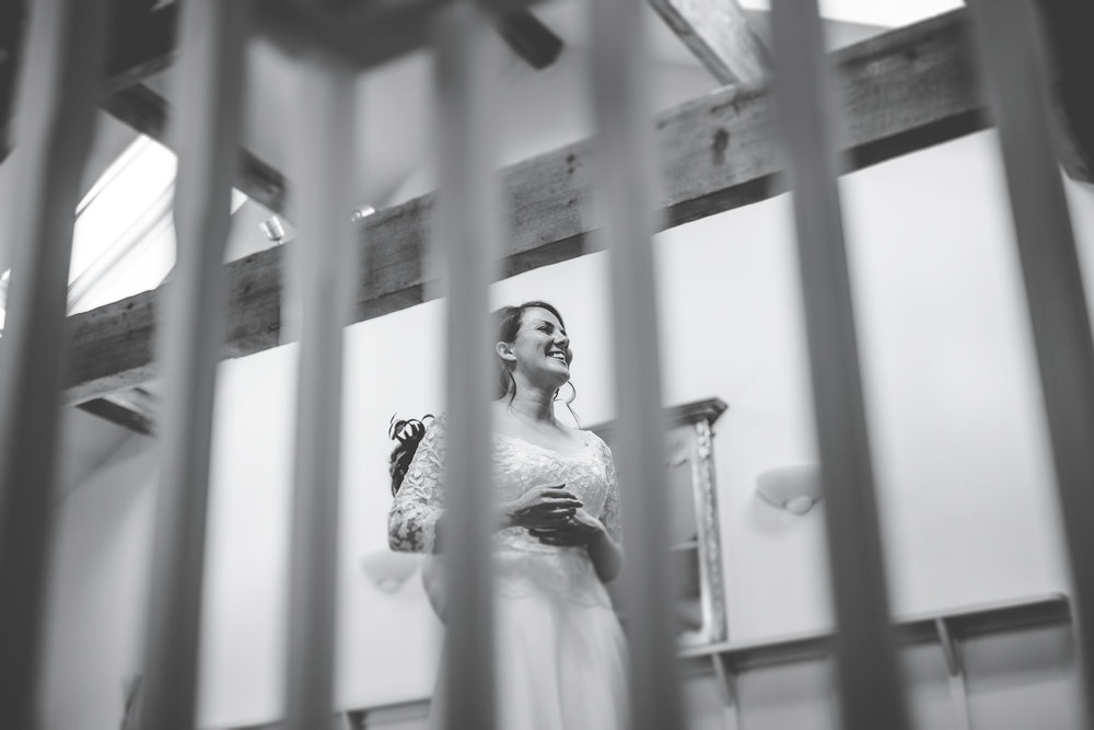 Black and white photograph of the bride smiling, Creative wedding photographer.