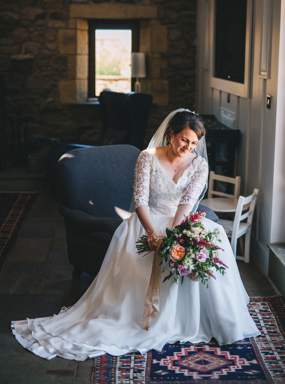 The bride and her bouquet, Rustic themed wedding.