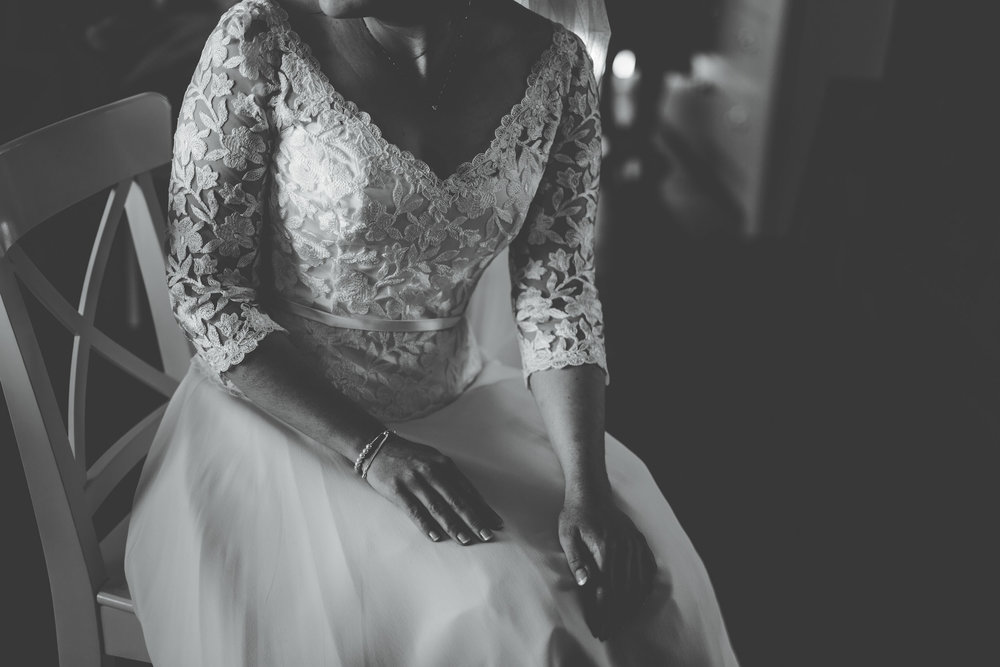 Black and white photo of the bride, hand-made wedding and lancashire wedding photographer.