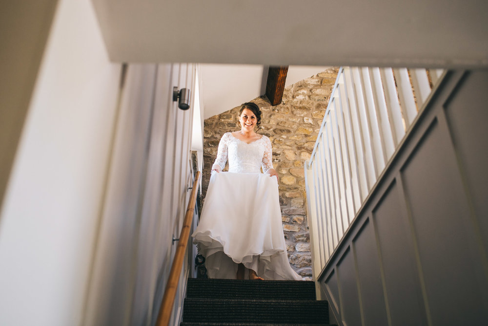 The bride walking down the stairs, Creative wedding photographer form Lancashire.