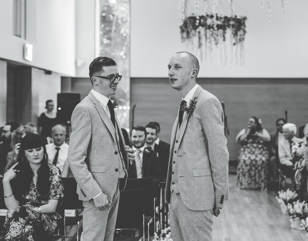 The groom and his best man at the alter, Documentary styled wedding photography.