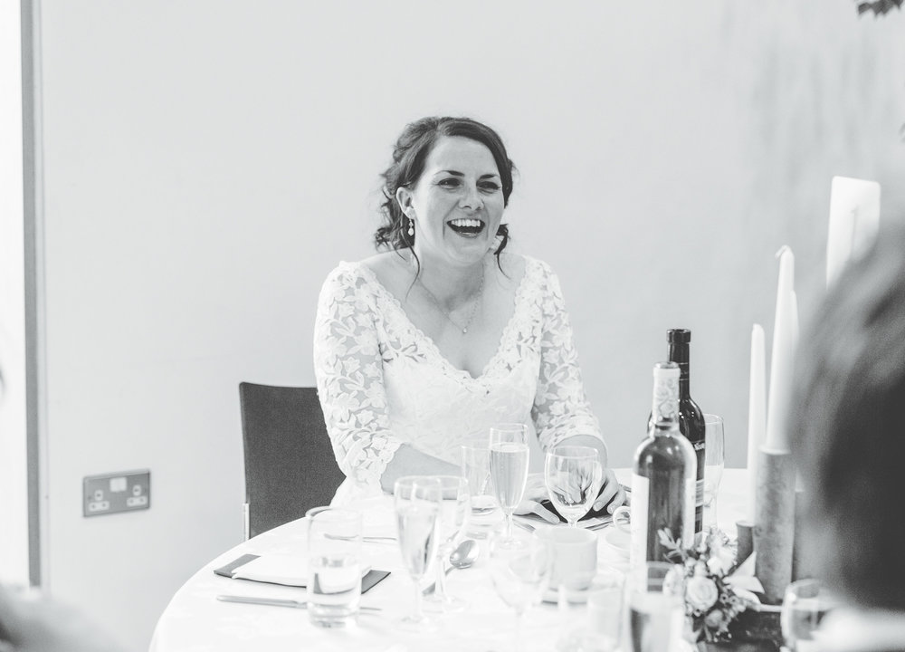 Black and white photograph of the bride during the wedding speeches, Creative wedding photographer from Lancashire.