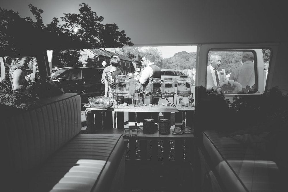 Through the window o the camper van, creative wedding photographer, black and white photography.