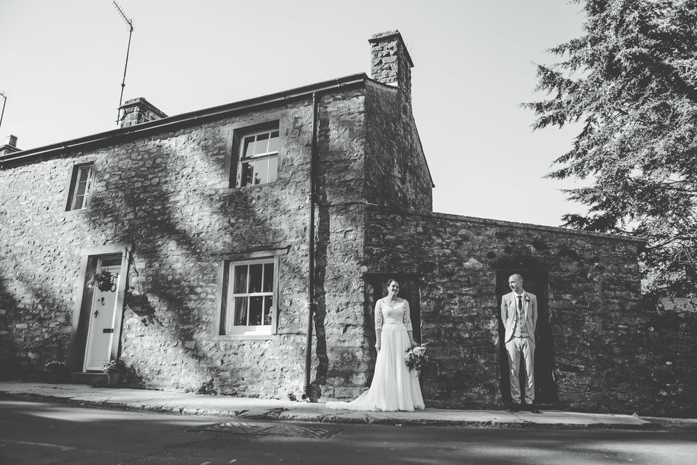 The bride and groom at the village hall in the ribble valley, black and white photography.