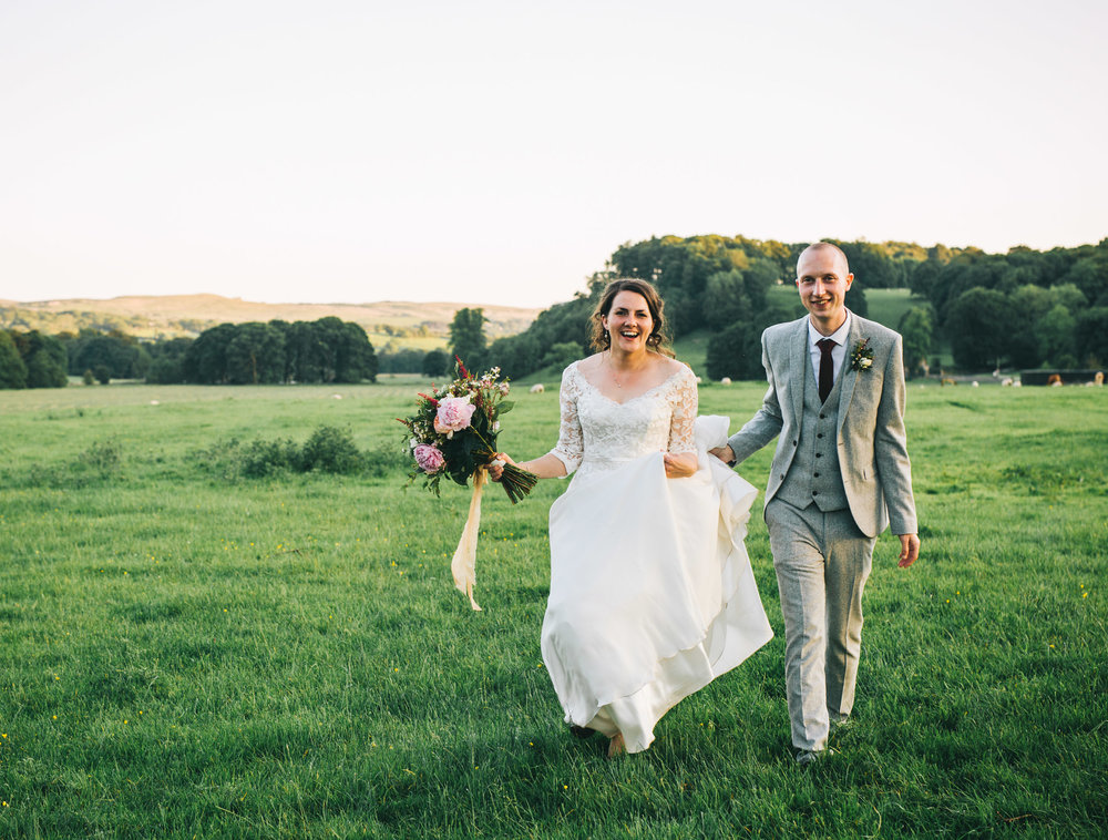 The bride and groom walking, documentary wedding photographer, creative wedding photographer from Lancashire.