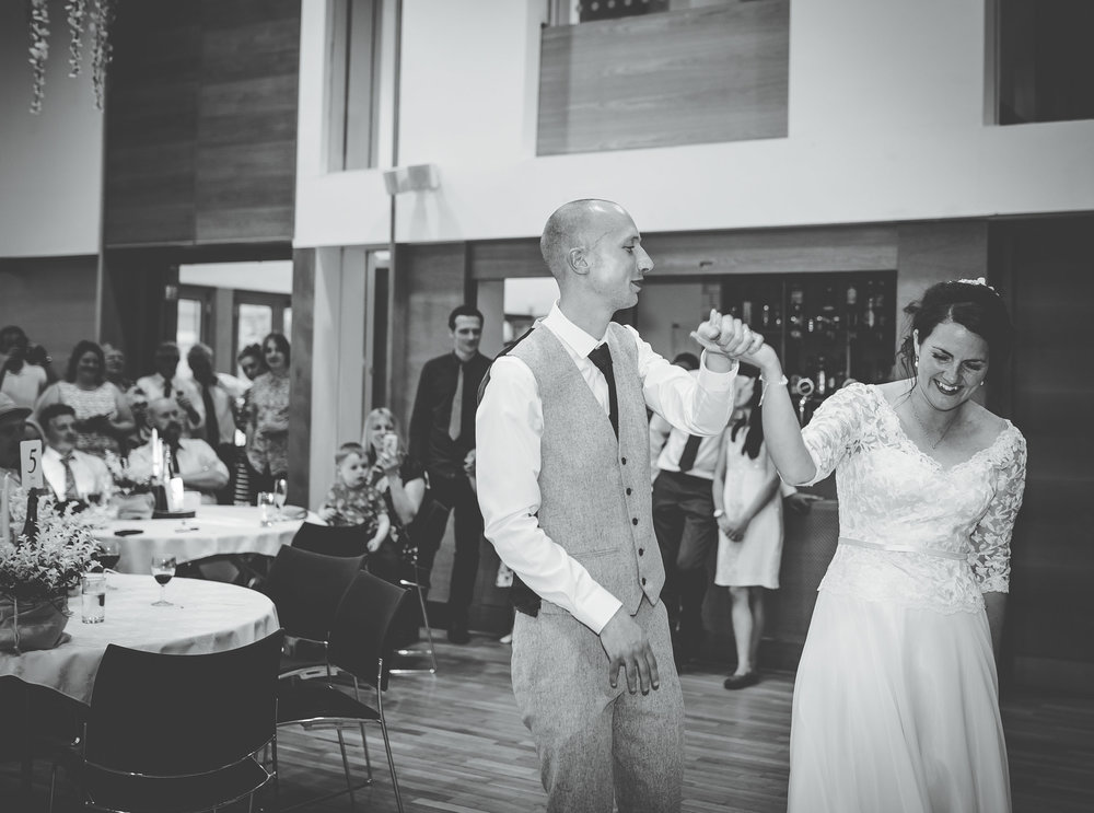 Black and white photograph of the bride and groom dancing, Rustic themed wedding in the Ribble Valley.