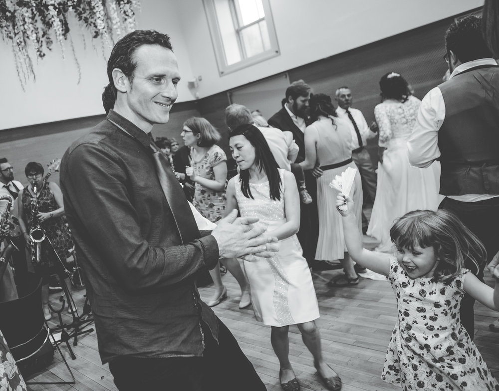 Black and white photograph of the wedding guests dancing, Documentary styled wedding photographer from Lancashire.