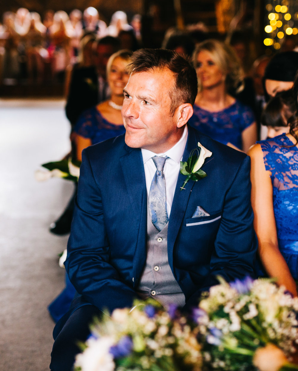 dad watches wedding ceremony with pride