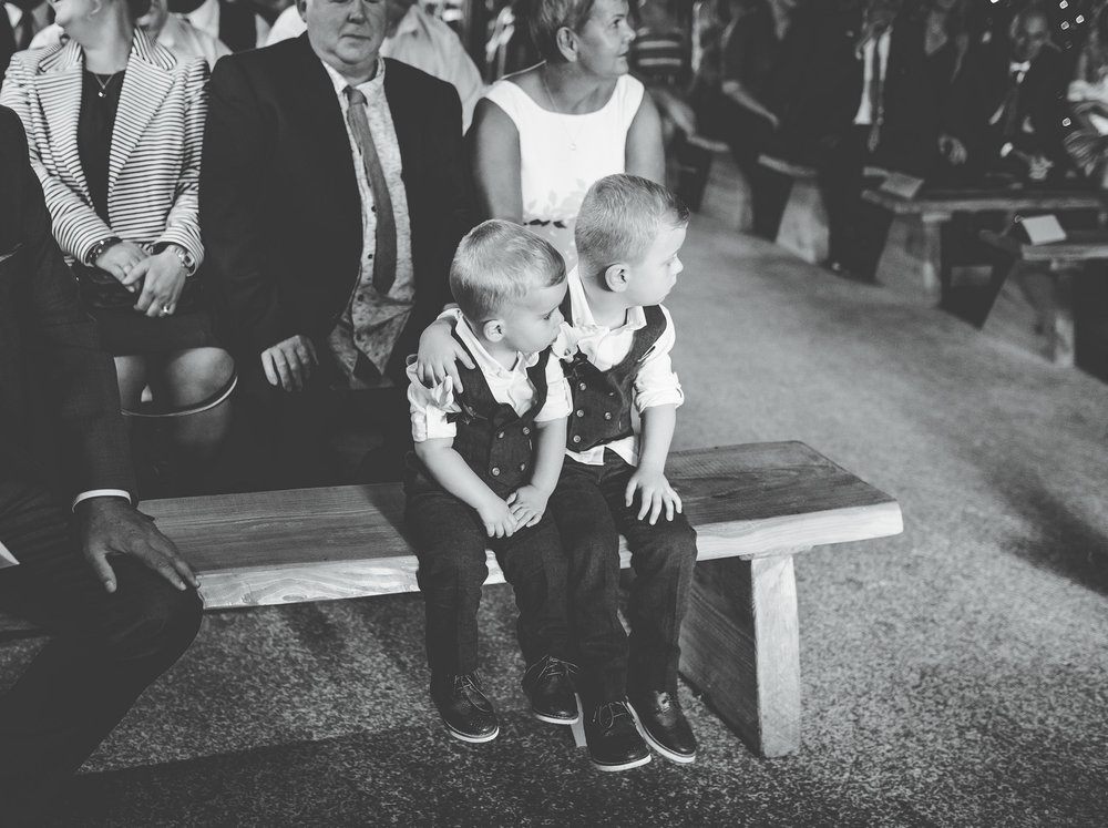 page boys holding hands - documentary wedding photographer