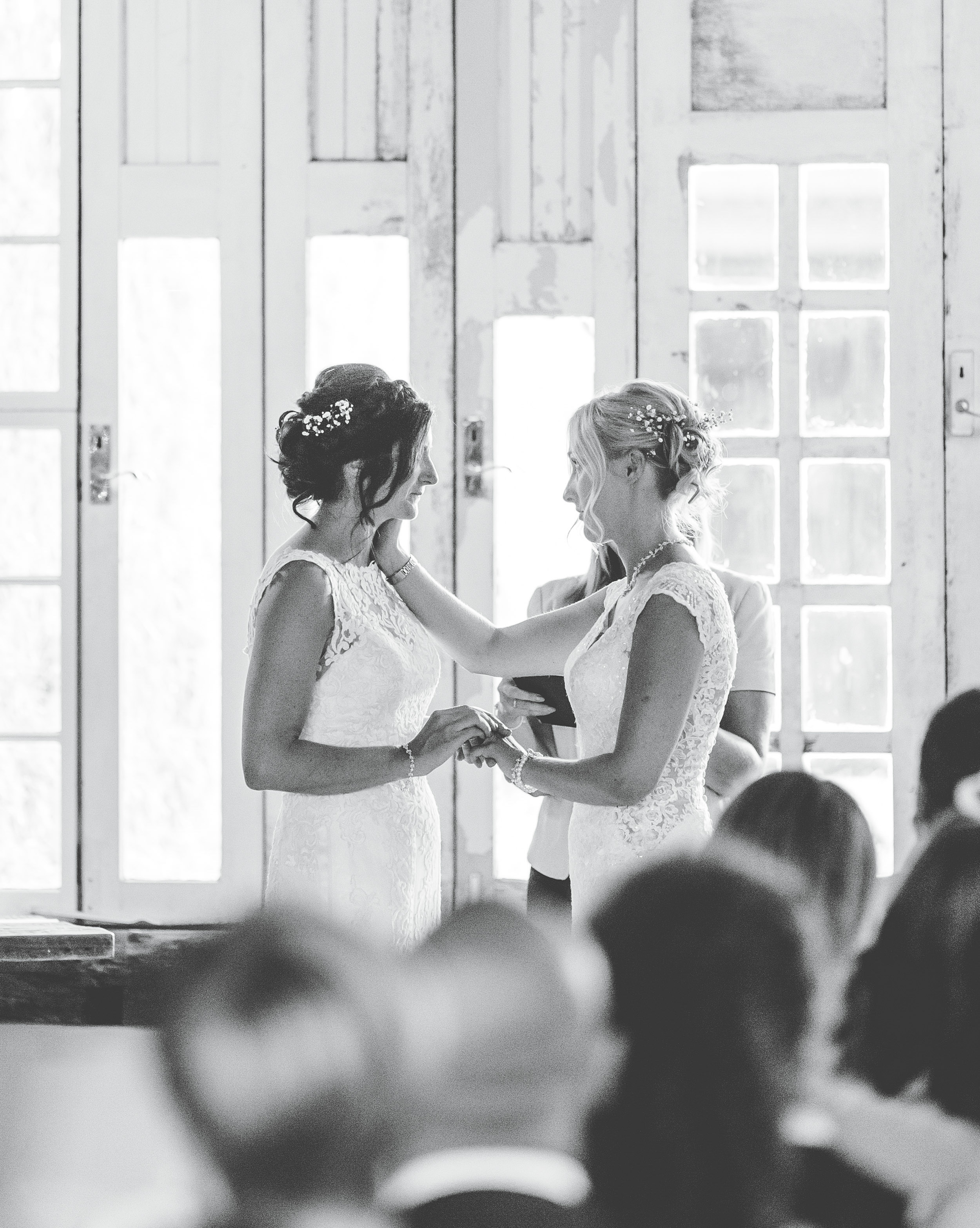exchanging vows - same sex wedding Owen House wedding barn cheshire