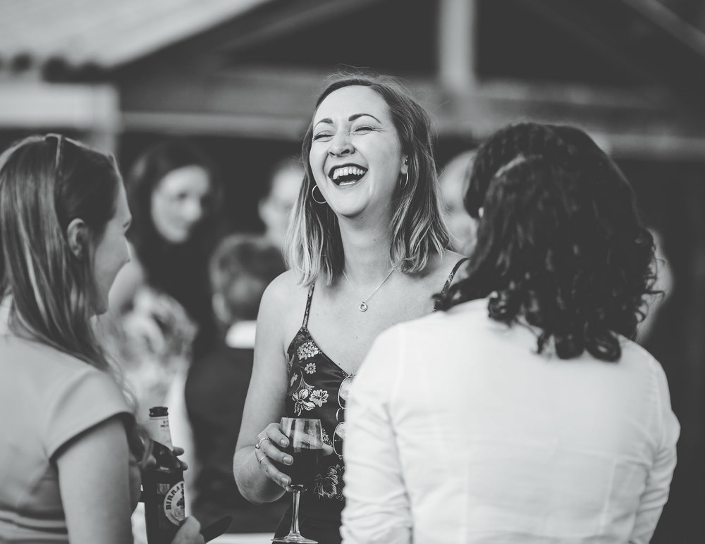 laughing guests at owen house wedding barn in cheshire