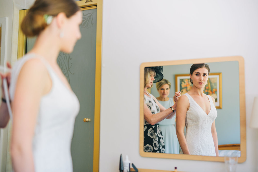 bride getting dressed - wedding photography in lancashire