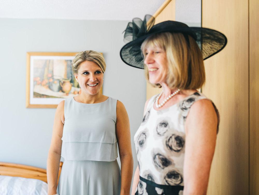 bridesmaid and mum smiling